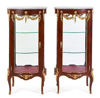 A Pair of Louis XV Style Gilt Metal Mounted Vitrines Height 50 3/4 x width 24 1/2 x depth 17 1/2 inches.