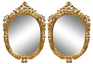 A Pair of Carved Giltwood Mirrors Height 49 x width 35 inches.