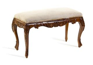A Louis XV Style Carved Bench Height 20 1/2 x width 35 x depth 16 1/8 inches.