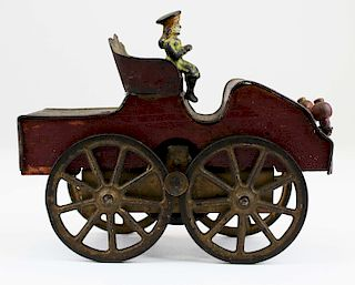 early automobile friction toy with cast iron rider