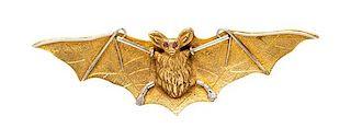 * An Art Nouveau Yellow Gold, Platinum and Ruby Bat Brooch, 5.60 dwts.