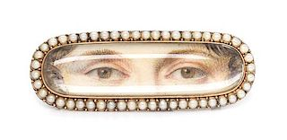 * A Georgian Yellow Gold and Seed Pearl Double Lover's Eye Plaque, 3.70 dwts.
