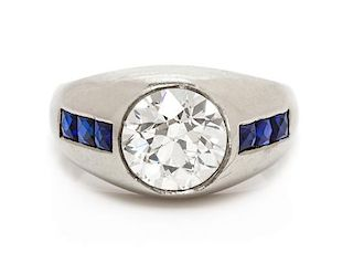 An 18 Karat White Gold, Diamond and Synthetic Sapphire Ring, 5.85 dwts.