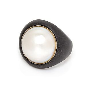 * An Art Moderne Blackened Steel, Platinum and Cultured Mabe Pearl Ring, Marsh & Co., 9.90 dwts.