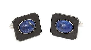 * A Pair of Art Moderne Blackened Steel, White Gold and Lapis Lazuli Cufflinks, Marsh & Co., 11.25 dwts.
