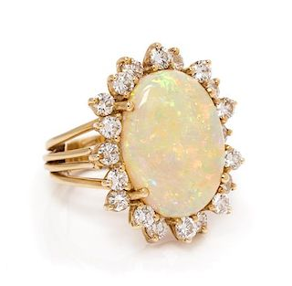 * A 14 Karat Yellow Gold, Opal and Diamond Ring, Pacific Gem Co., 5.90 dwts.