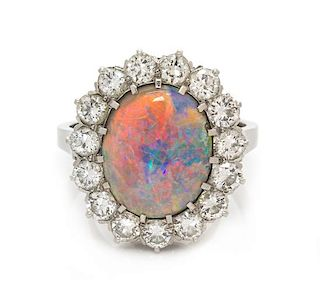 A Platinum, Opal and Diamond Ring, 5.85 dwts.