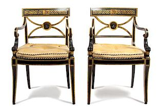 A Pair of Regency Style Painted and Gilt Armchairs Height 33 inches.
