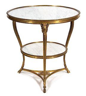 An Empire Style Gilt Bronze Guéridon Height 27 1/2 x diameter of top 28 inches.