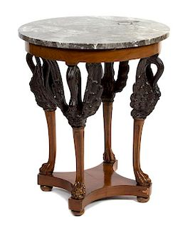 An Empire Style Parcel Ebonized Side Table Height 28 x diameter of top 23 inches.