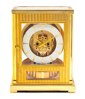 A LeCoultre Brass and Glass Atmos Clock Height 7 inches.