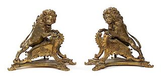 A Pair of French Gilt Bronze Figural Chenets and Fire Fender Height of chenets 15 inches.