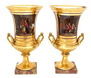 A Pair of Paris Porcelain Urns Height 15 inches.