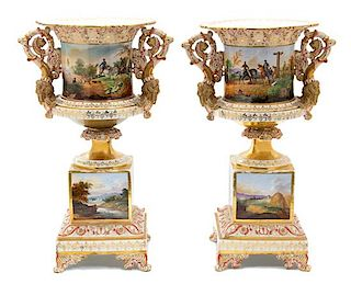 A Pair of Continental Porcelain Urns Height overall 21 inches.