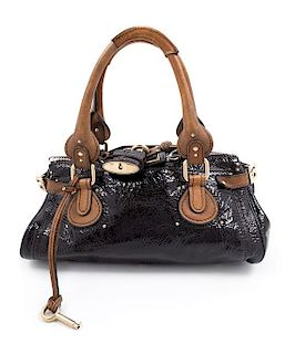 "A Chloe Black Patent Paddington Bag, 6.5"" H x 14.5"" W x 8"" D; Handle drop: 8""."