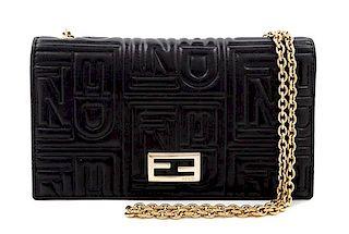 "A Fendi Black Monogram Embossed Leather Wallet/Shoulder Bag, 7.5"" L x .75"" W x 4"" H; Chain strap drop: 19""."