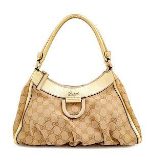 """A Gucci Beige Monogram Gold D Ring Handbag, 8.5"""" H x 12"""" W x 4.5"""" D; Handle drop: 7""""."""