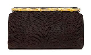 "A Gucci Brown Snakeskin Clutch, 4.75"" H x 8.25"" W x 1.25"" D."