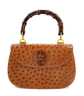 """A Gucci Brown Ostrich Bamboo Top Handle Handbag, 7"""" H x 10.5"""" W x 2.5"""" D; Handle drop: 4.5""""."""