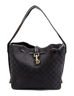 "A Gucci Black Monogram Canvas Square Shoulder Bag, 10.5"" H x 11"" W x 3"" D; Shoulder strap: 8.5""."