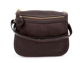 """A Gucci Brown Leather Vintage Reversible Saddle Shoulder Bag, 9.75"""" H x 10.75"""" W x 2"""" D; Strap drop: 8.5""""- 9""""."""