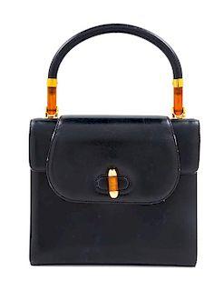 "A Gucci Navy Leather Vintage Flap Handbag, 7.25"" H x 8"" W x 2.75"" D; Handle drop: 4""."