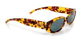 A Pair of Gucci Tortoiseshell Sunglasses,