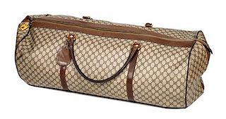 """A Gucci Monogram Canvas Duffle Bag, 11"""" H x 31"""" W x 15"""" D; Handle drop: 8.5""""."""