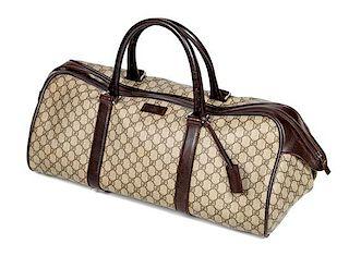 """* A Gucci Monogram Canvas Duffle Bag, 9.5"""" H x 21.5"""" W x 10.5"""" D; Handle drop: 6""""."""