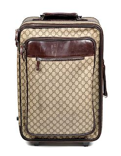 """* A Gucci Monogram Canvas Roller Suitcase, 22"""" H x 15.25"""" W x 9.25"""" D; Handle: 1.25""""."""