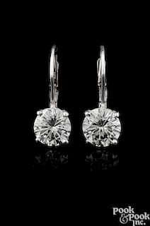 Pair of 14K white gold diamond stud drop earrings