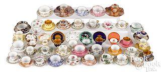 Miniature china tea cups and saucers