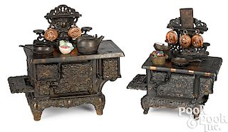 Two cast iron child's toy stoves