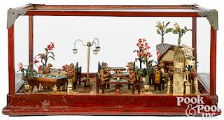 Gambling parlor game room in glass display case