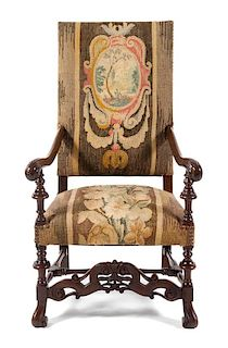 A Louis XIII Style Fauteuil Height 47 1/4 inches.
