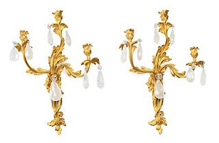 A Pair of Louis XV Style Gilt Bronze and Rock Crystal Three-Light Sconces Height 26 inches.
