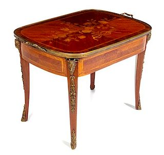 A Louis XV/XVI Transitional Style Gilt Metal Mounted Marquetry Side Table Height 20 3/4 x width 28 1/2 x depth 18 7/8 inches.
