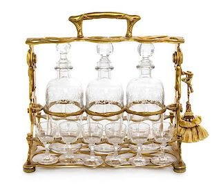 A French Gilt Metal and Glass Tantalus Width 11 1/2 inches.