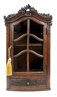 A Louis XV Provincial Style Oak Hanging Vitrine Height 30 1/2 inches.