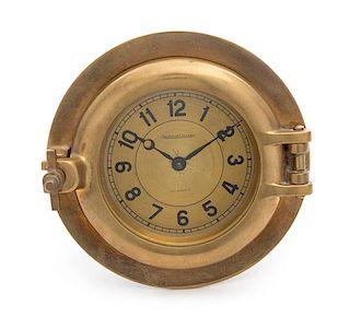A Swiss Brass Ship's Clock Diameter 6 1/2 inches.
