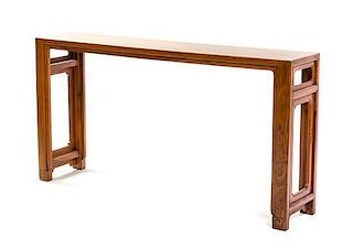 A Contemporary Huanghuali Table Height 31 1/2 x width 60 x depth 13 inches.