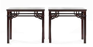 A Pair of Hardwood Tables Height 32 x width 37 x depth 19 1/2 inches.