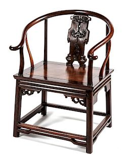 A Carved Hardwood Horseshoe Back Chair Height 35 inches.