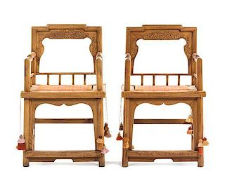 A Pair of Carved Wood Armchairs Height 37 inches.