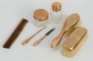14 karat gold travel set in original leather fitted case,  including two covered glass jars, two brushes, boot hook, comb, and nail ...