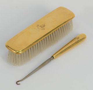 Tiffany & Co. 18 karat gold two piece set,  brush and boot hook, marked Tiffany & Co. Makers.  brush: length 7 inches   Provenance: ...