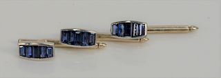 Cartier set of three white gold buttons, set with five baguette cut sapphires in each