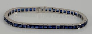 Cartier platinum and sapphire in line bracelet #15921. length 6 7/8 inches, 21.8 grams