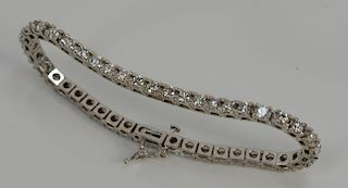 14 karat white gold tennis bracelet containing forty-four round diamonds, approximately 5 cts.  total length 7 inches, 13.4 grams to...