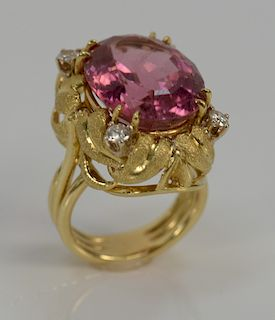 18 karat gold ring, set with pink tourmaline approximately 15 cts., each corner set with one single round brilliant cut diamond .32...